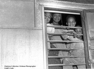 Four Black Children smiling for a reporter.