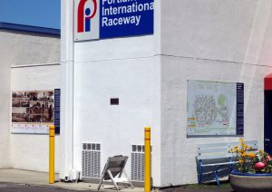 View of Portland International Raceway (PIR) offices with two historic Vanport banners.