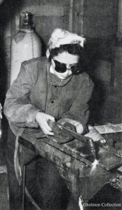 Women working WWII, Wearing darkened safety glass and hair covered. Gholston Collection