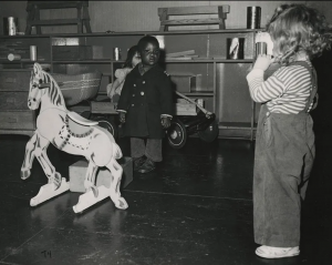 Toddlers at Vanport Childcare. An African American and two white children playing together.